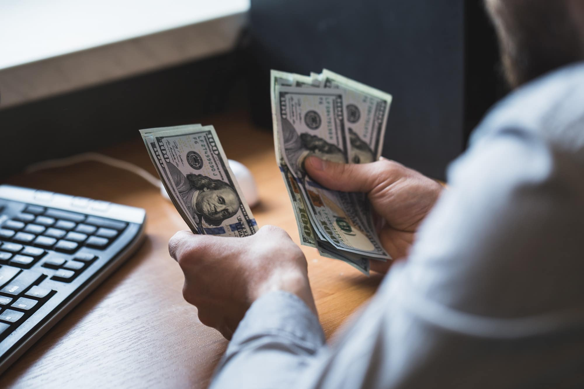 Businessman is counting dollars banknotes, business and financial background